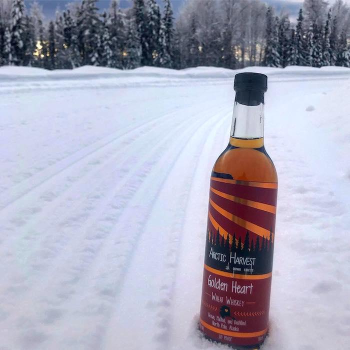 Arctic Harvest whiskey in snow